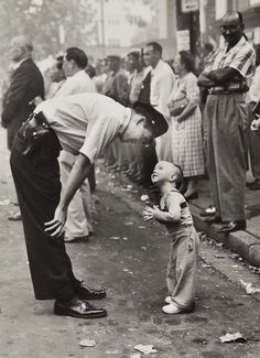 William C. Beall  Faith and Confidence, 1958  A policeman speaks to a young boy at a parade in Washington, D.C. for the Washington Daily News.  1958 Pulitzer Prize for Photography - Courtesy Scripps Howard News Service