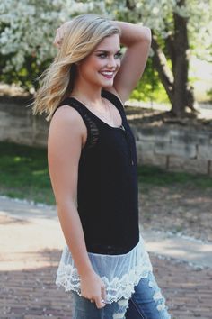 Trade out your usual tank for this fun, lace detailed tank! Our Trade Winds Top is a black, open knit tank, with a round neckline featuring a contrasting white lace hemline. This tank is see-thru! Loo