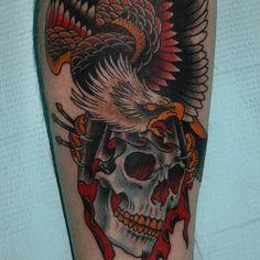 Eagle perched atop a bleeding skull