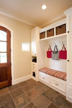 Mud Room featuring a custom cushion with Ralph Lauren fabric, custom cubby for kitty litter box, built-in storage for children's backpack & jackets accented by bead board.