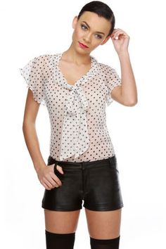 Check it out from Lulus.com! Brush the flour off your skirt and slip into the Betsy Bake Sale Ivory Polka Dot Top for a day of sugary sweet delight! Cute black polka dots adorn a background of sheer ivory silk-blend chiffon, with a soft ascot collar and high-low hem. Short cape sleeves. Unlined and SHEER. Top measures 23