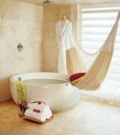 A bathroom with a round tub and hammock… dreamy  (via Beautiful Bathrooms)...I want a hammock in my bathroom...