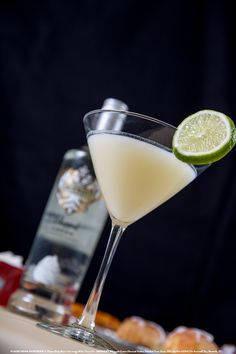 Key Lime Cream Pie Martini with 2 oz Smirnoff® Whipped Cream Flavored Vodka, 1 oz pineapple juice, 0.5 oz fresh lime juice, and 0.5 oz half and half cream. In an ice filled shaker combine all the ingredients. Shake well. Strain into a chilled martini glass rimmed with crushed graham crackers (optional). Garnish with a lime round. #Smirnoff #drink #recipe #fall #thanksgiving #keylimepie #dessert
