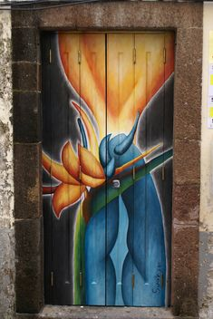 Painted door in the city of Funchal, Madeira, Portugal. Some of the doors have the artist's signature and some don't. Painted doors: Blowing a kiss Cool Doors, Unique Doors, Portal, Entrance Doors, Doorway, Funchal, Apartment Painting, When One Door Closes, Door Gate