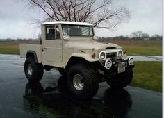 60's FJ45 Dune Beige Land Cruiser 4x4 Skyjacker Lift - Mickey Thompsons
