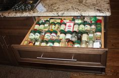 store your spices in a drawer. But don't just throw them all in there. Organize them in rows so you can read the labels.