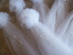 Pom Pew Bows, Tulle and Pearl Bows, Church Pew, Pew Bows, Aisle Decor, Quinceanera Decorations, Chair Hangers, OVER 20 COLORS by OneFunDay on Etsy https://www.etsy.com/listing/115108221/pom-pew-bows-tulle-and-pearl-bows-church