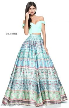 Sherri Hill 51204 is a 2-piece ball gown with a solid colored, off the shoulder crop top and a multi print skirt.