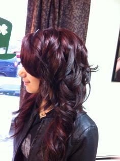 Violet Red highlights on a Darkest Brown, long layered shag.
