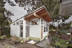 Modern Tiny House --imagine the light inside; like the long overhang in front.
