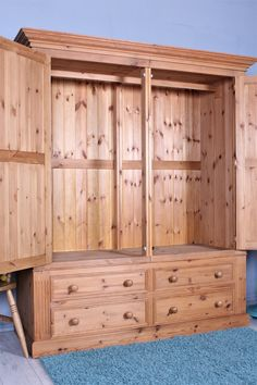 £350  Very large double pine wardrobe, waxed with 4 large drawers, comes in 4 sections so most staircases will be accessible -  http://www.sussexpineonline.co.uk/gb/