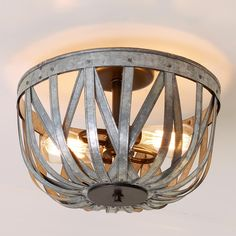 "Galvanized Straps Basket Ceiling Light This galvanized metal openwork basket ceiling light will add rustic, industrial style to your home. (9""Hx13""W) 2 x 60 watt medium base sockets."