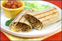 Ingredients: 1/4 cup chopped onion 3/4 cup frozen ground-beef-style soy crumbles (like the kind by Boca or MorningStar Farms) 1/8 tsp. cumin 1/8 tsp. chili powder 1/8 tsp. garlic powder 1 La Tortilla Factory Smart & Delicious Low Carb High Fiber Large Tortilla 2 tsp. fat-free sour cream