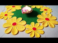 The purpose of rangoli is decoration, and it is thought to bring good luck. Rangoli is considered auspicious as it signifies showering of good luck and prosp. Rangoli Designs Simple Diwali, Happy Diwali Rangoli, New Year Rangoli, Rangoli Simple, Indian Rangoli Designs, Rangoli Designs Flower, Small Rangoli Design, Colorful Rangoli Designs, Rangoli Patterns