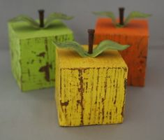 Yellow, pealing paint and square. This primitive wood apple is made from 100% recyceld materials. Use as a bookend, paper weight or sit it on a table or desk as an accent to your country cottage decor.    Size of Apple with Stem: 5.25 x 4.25  Size of Wood / Apple: 3.5 x 3.5  Materials: Stem is a hardcut flooring nail, the leaves are made from recycled / rusted barn tin and the apple is made from a recycled wooden post    This is an original design. Since these are handmade, each apple, stem…
