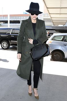 Khloe Kardashian at LAX Airport (April 27, 2015), wearing a Pierre Balmain Double Breasted Long Coat, a Maison Michel hat, a Givenchy Antigona Medium Duffel Bag and Tom Ford Suede Padlock Ankle-Strap Pumps. #khloekardashian #style