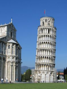 Pisa, Italy. It started leaning while they were building it in 12 c. Notice the slight effort to correct it.