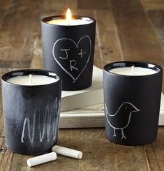 Pick up some cheap glass candleholders at your local craft store, the local dollar store, or even Ikea. Then grab a can of chalkboard spraypaint and go to it. Simple, cheap, adorable.