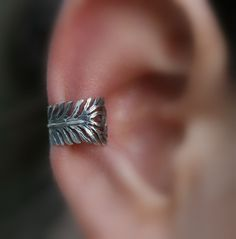 Sterling Silver Handcrafted Feather Textured by Holylandstreasures, Ear cuff. I like the whole, no pierce thing! @Maria Little It's a peacock feather!