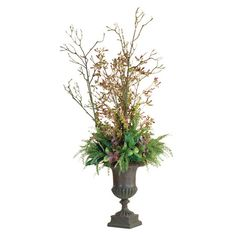 Handcrafted faux mixed greenery arrangement in an urn-inspired planter.  Product: Faux floral arrangementConstructio...