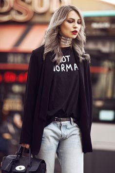 graphic tee with chic blazer and silver choker