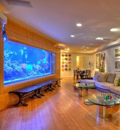 Fish Art Art and aquarium make a statement on opposing walls. Wall Aquarium, Home Aquarium, Aquarium Design, Marine Aquarium, Aquarium Fish Tank, Dream Home Design, Home Interior Design, House Design, Relaxation Room