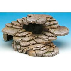 This Shale Step Ledge and Cave Hide-Out is a beautifully detailed, realistic rock formation that can be used wet or dry environments. Perfect for fish tanks as well as reptile habitats. Cave effect to creep or swim into and your pets will love the hide-out feature. Steps and cave have realistic features!