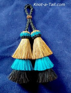 Unique triple layer double tassel Rare beauty.  Sorrel/teal/black horsehair tassel http://knot-a-tail.com/catalog/16