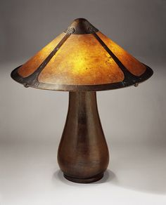 Lamp, ca. 1912–15. Dirk Van Erp. San Francisco, CA. Copper, mica. This lamp features a mica shade that crowns the hand-hammered baluster-shaped base of a rich reddish brown copper. The lamp was not produced before 1910 and it is likely to have been a collaboration between the two designers. After D'Arcy Gaw left, Van Erp's studio continued to produce the designs.
