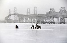 A tractor tows a sled across the Chesapeake Bay during the Big Freeze of 1976-1977.