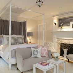 SB Long Interiors - bedrooms - gray bedroom, bedroom fireplace, fireplace in bedroom, flokati rug, white flokati rug, gray loveseat, lovesea...