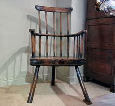 A substantial late 18th century Welsh comb back Armchair with its original legs, yes, only three!