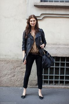 Simple everyday: black skinnies, flats, taupe blouse and black leather jacket. Stockholm streetstyle Via Dress Like Mi