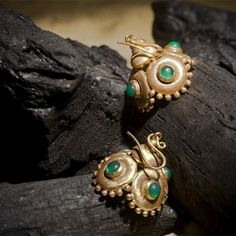 Uncut Emerald cob Contemporary Jhumkhas: Finely handcrafted jhumkhas studded with uncut emeralds with a unique texture handcrafted in 18k yellow gold