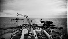 Curtiss SC-1 Seahawk spotting plane being hoisted aboard USS IOWA (BB-61), off San Francisco, July 1947