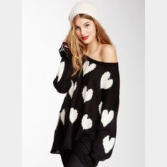 New Wildfox Couture All Over Love Lennon Sweater New, never worn, Wildfox Couture All Over Love Lennon Sweater in Clean Black size xs. Seen on countless celebrities, soft sweater will all over white heart design and distressing at hem and cuffs. Wildfox Sweaters Crew & Scoop Necks