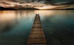 Stunning photography by Meg Lipscombe, pinned from the Rotorua Camera Club website. Lake Tarawera at dawn