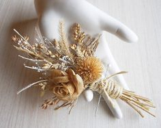 Rustic Boutonniere, made of dried millet, dried grass, coffee stained rose, dried daisy center, babies breath, burlap and twine. on Wanelo