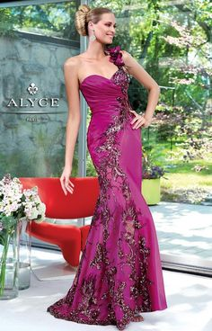 Gorgeous and unique, Alyce Paris 6049 is a dress that will truly wow the crowd. A one shoulder strap creates a trendy look while the mermaid fit shows off your hourglass figure! Fabulous floral embroidery starts at the strap and trails all the way down to the bottom of the skirt. The magenta color is absolutely magical and perfect for any skin color!