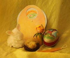 Easter Exchange- Wool rabbit, yarn chicks in a knitted nest, daffodil child, German paper egg, beeswax candles, and a moving picture Easter card.