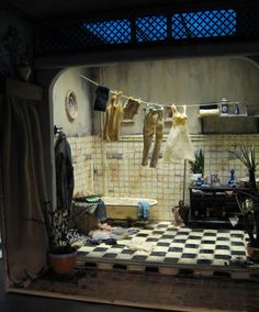 Bathroom  wonderful diorama..or as we say in swedish tittskåp. Here is both outside and inside decor shown. Love it