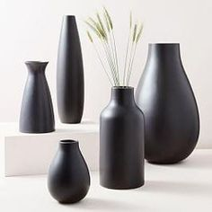 Made of ceramic earthenware with a smooth finish, our Black Vases come in a range of shapes and sizes. Collect a few for countless arrangement possibilities on mantels, ledges and tabletops. Black Vase, White Vases, Slab Ceramics, White Ceramics, Spray Paint Ceramic, Vase Shapes, Vases Decor, Ceramic Vase, Porcelain Ceramics