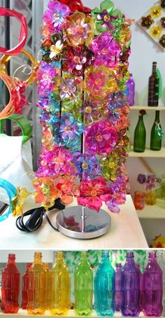 like the colors and clear shininess. made of plastic bottles? Plastic Bottle Flowers, Plastic Bottle Crafts, Plastic Art, Recycle Plastic Bottles, Soda Bottle Crafts, Diy Bottle, Recycled Art Projects, Recycled Crafts, Crafts To Make