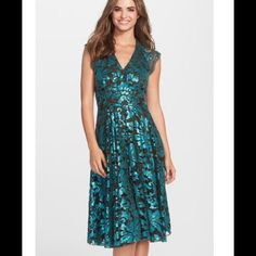 Eva Franco Sequin Lace Dress in Teal Teal sequins in lacy patterns give vivid glitz to this comfortable, swingy cocktail dress. Color: TEAL FANFAR Eva Franco Dresses Wedding