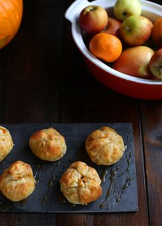 Whatever happened to apple dumplings? Seems like canned pumpkin products, donuts, and apple crumbles pushed them off our fall cooking agendas and I would like to personally see to it that this in. Crab Apple Recipes, My Recipes, Sweet Recipes, Favorite Recipes, Finger Food Desserts, Mini Dessert Recipes, Delicious Desserts, Baked Apples, Crab Apples