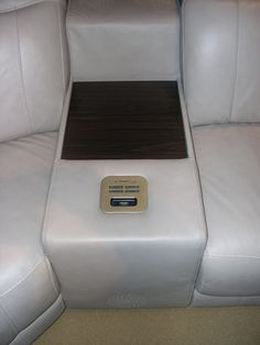HTL Leather Sofa - Note the built-in media console. USB, SD Card reader, iPod dock, volume control and wood media rest.