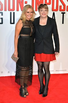 "Eddie Izzard Photos - Carol Vorderman and Eddie Izzard attend an exclusive screening of ""Mission: Impossible Rogue Nation"" at BFI IMAX on July 2015 in London, England. - Celebs Hit the Red Carpet of the 'Mission: Impossible Rogue Nation' Premiere Man Skirt, Dress Skirt, Peplum Dress, Pantyhose Outfits, In Pantyhose, Nylons, Carol Vorderman Pictures, Men Wearing Skirts, Eddie Izzard"