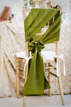 Asymmetrical olive satin chair bows. Photography by archetypestudioinc.com, Event Planning, Event Design by tamaramenges.com