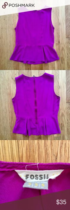 Fossil Silk Peplum Top Beautiful, magenta peplum top by Fossil. 100% silk and unique zipper back. Size small. Cleaned but never worn. Feel free to ask any questions or make me an offer! Fossil Tops Blouses