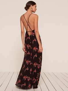 Fancy. This is an open back, floor length dress with a very high slit and v neckline.